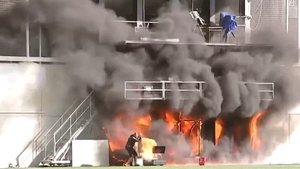 The TV gantry at the side of the stadium was engulfed in flames