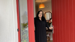 Jean Cosgrove at the front door of her new home in Claregalway