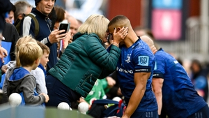 Adam Byrne celebrates with his mother Gillian after his comeback against Zebre