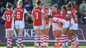 Katie McCabe celebrates scoring Arsenal's opening goal with her team mates