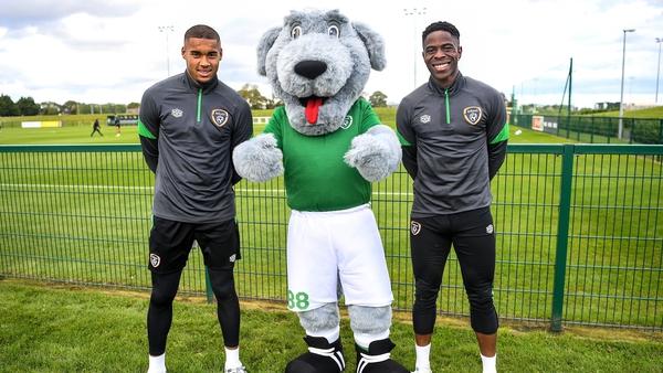 Gavin Bazunu and Chiedozie Ogbebe pose with Ireland mascot Macúl after returning from Azerbaijan