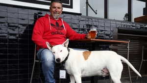 Scott Pearson enjoys a beer, with his dog Wilbur beside him, in Surry Hills, Sydney today