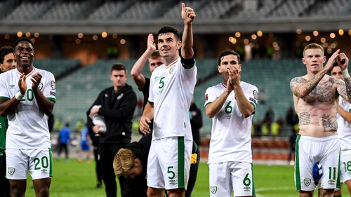 Ireland players salute the fans after the win in Baku