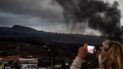 A stream of red-hot lava gushing from the Cumbre Vieja volcano engulfed a cement plant