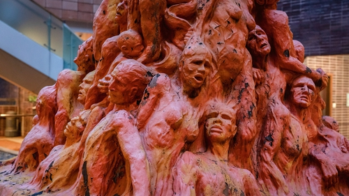 The statue features 50 anguished faces and tortured bodies piled on one another