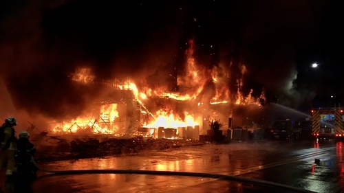 The flames tore through the building in Kaohsiung