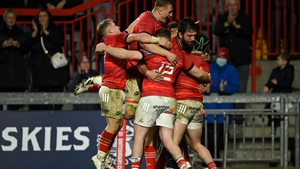 Munster players celebrate Chris Cloete's opening try