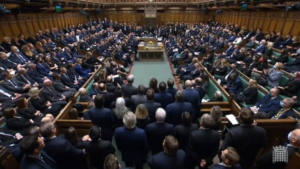 Members of parliament, many dressed in black, packed the House of Commons and stood heads bowed for a minute's silence