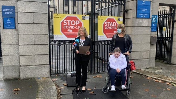 Caitlin Twomey and her mother Michelle watch solicitor Anne Marie Donnelly read a statement welcoming the €8m interim settlement