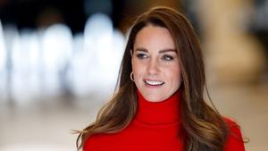 Kate Middleton stuns in monochrome scarlet ensemble. Photo: Getty