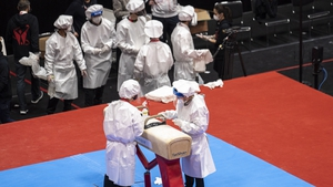 The pommel horse is disinfected at the Kitakyushu City General Gymnasium