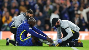 Romelu Lukaku receives attention on the ankle injury that forced him off
