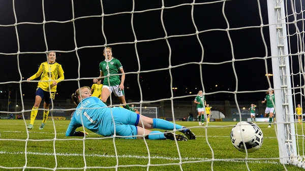 Courtney Brosnan looks on as the ball trickles into the net for Sweden's goal