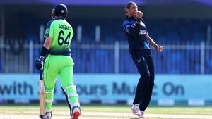 David Wiese of Namibia celebrates the wicket of Ireland's Gareth Delany