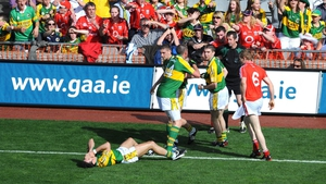 Aidan O'Mahony lies on the ground after an altercation with Donncha O'Connor during the 2008 All-Ireland SFC semi-final
