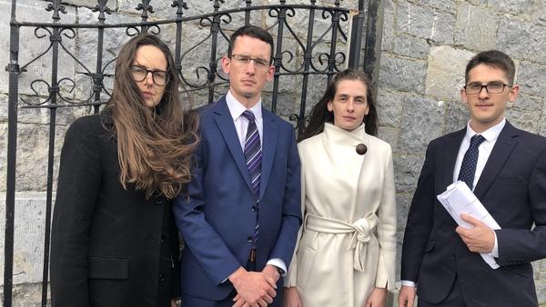 Ammi, Enoch, Kezia and Isaac Burke outside court