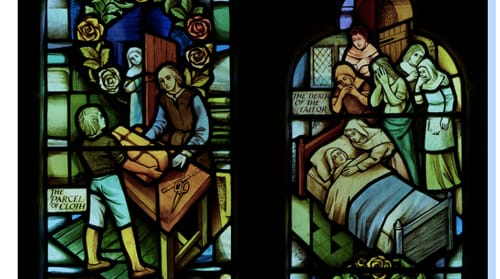 A stained glass window in the church of St Lawrence in Eyam illustrates the onset of the plague. Photo: Simon Norfolk https://simonnorfolk.com/