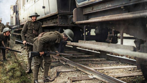 British soldiers inspect a train in Kerry during the war of Independence. Original image from the National Library of Ireland, colourised by John Breslin