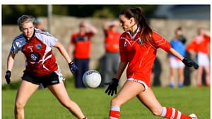 Amy Ryan drives forward during a club championship game in the colours of her club Oola